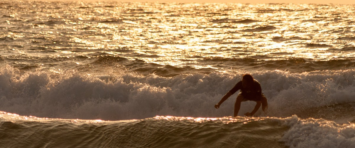 Sunset while surfing the waves. Idyllic..